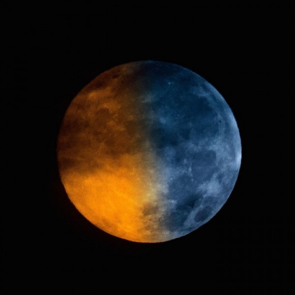 Blue moons don't really look blue in color.  Greg Hogan got this shot of a Blue Moon (blue in name only!) on July 31, 2015.  He wrote: