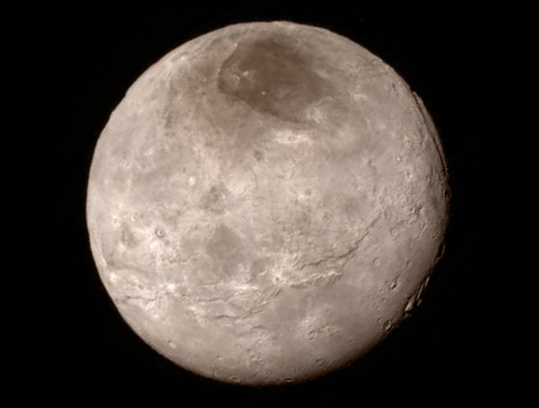 View larger.   Pluto's largest moon Charon has a surprisingly youthful and varied terrain, with cliffs, troughs and a dark marking nicknamed 'Mordor' in the moon's north polar region.  New Horizons image taken when the craft was closest to the Pluto system on July 14, 2015.