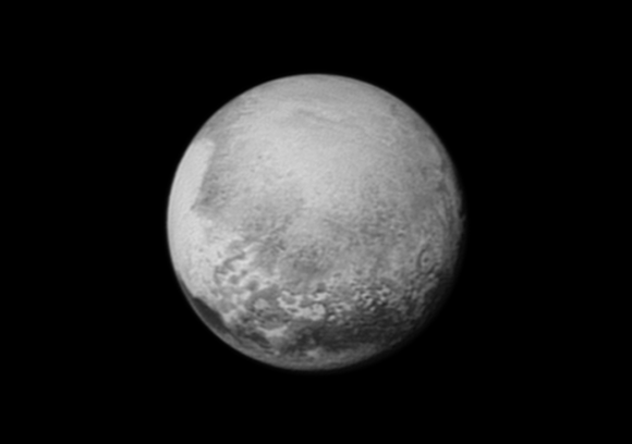 """Pluto's bright, mysterious """"heart"""" is rotating into view, ready for its close-up on close approach, in this image taken by New Horizons on July 12 from a distance of 1.6 million miles (2.5 million kilometers). It is the target of the highest-resolution images that will be taken during the spacecraft's closest approach to Pluto on July 14. The intriguing """"bulls-eye"""" feature at right is rotating out of view, and will not be seen in greater detail. Image credit: NASA/JHUAPL/SWRI"""