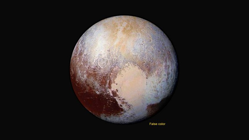 View larger. | Four images from New Horizons' Long Range Reconnaissance Imager (LORRI) were combined with color data from the Ralph instrument to create this enhanced color global view of Pluto. (The lower right edge of Pluto in this view currently lacks high-resolution color coverage.) The images, taken when the spacecraft was 280,000 miles (450,000 km) away, show features as small as 1.4 miles (2.2 km). Image via NASA/JHUAPL/SwRI.