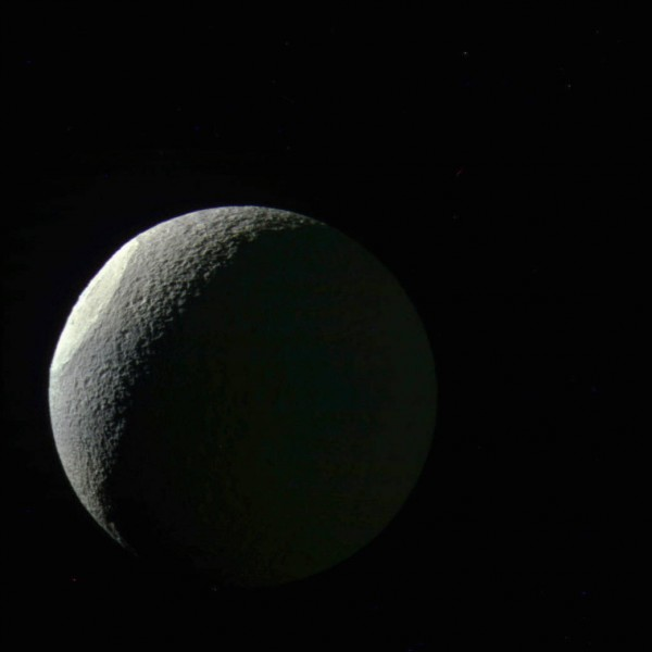 View larger. | Saturn's moon Tethys, as captured by the Cassini spacecraft on May 9, 2015 at a distance of approximately 186,000 miles (300,000 km) from Tethys. Ultraviolet, green and infrared spectral filters were combined to create this color view. North on Tethys (660 miles or 1,062 km across) is up in this view.  Image via NASA/JPL-Caltech/Space Science Institute