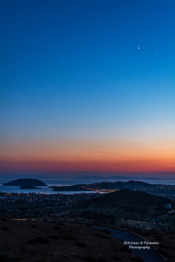 Xristos X. Paravalos Photography posted this photo at EarthSky Facebook on July 7, 2015.  It's Venus and Jupiter over the Saronic Gulf, Anavissos, Greece.