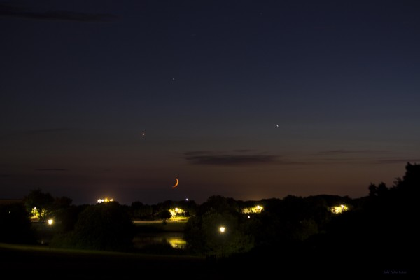 View larger. | Venus, Jupiter and the moon setting on July 18 as seen from Porto, Portual.  The star above the planets is Regulus in the constellation Leo.  Photo submitted by João Pedro Bessa.