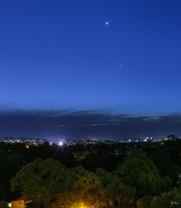 View larger. | Venus (brightest), Jupiter (second-brightest) and star Regulus make a triangle.  The comet is to their lower left.  Composite image - created from two images - taken on July 22, 2015 by Marco Nero in New South Wales, Australia.  Canon EOS 6D with Canon EF 85mm f/1.2L USM II lens.