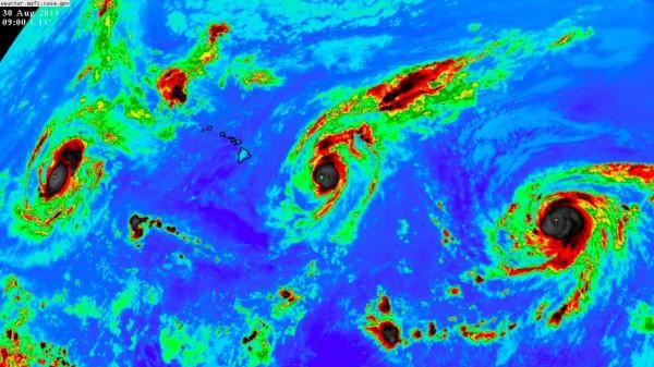 Three Category 4 hurricanes on Sunday morning in the Pacific. Kilo (left), Ignacio (center) and Jimena (right).  Image via NASA.