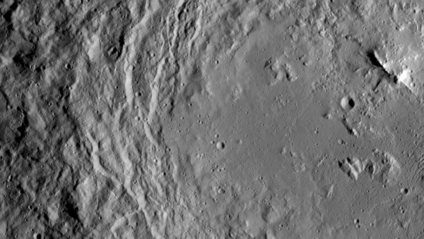 View larger. | Here a large portion of the 163-km / 101-mile-wide Urvara Crater within Wayu Quadrangle in the southern hemisphere on 1 Ceres. I have rotated the images so north is top.