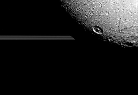 Saturn's moon Dione hangs in front of Saturn's rings in this view taken by NASA's Cassini spacecraft during the inbound leg of its last close flyby of the icy moon. Image credit: NASA/JPL-Caltech/Space Science Institute