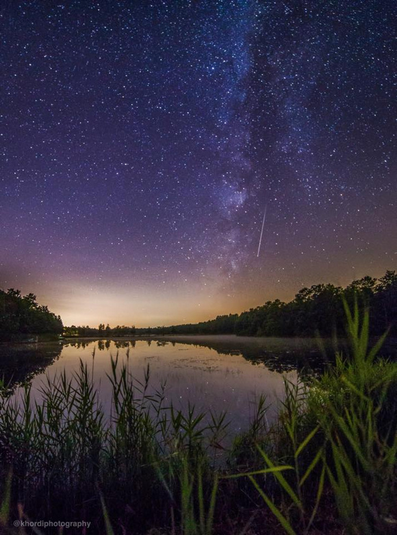 View larger. Jennifer Khordi's photo of a Perseid meteor running the length of a dim and setting Milky Way in the early morning hours of last night's meteor shower. Taken in the Pine Barrens, New Jersey. Thank you Jennifer!