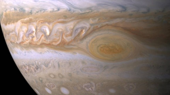 Trapped between two jet streams, the Great Red Spot is an anticyclone swirling around a center of high atmospheric pressure that makes it rotate in the opposite sense of hurricanes on Earth. Image credit: NASA/JPL/Space Science Institute