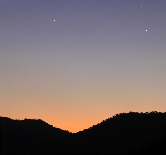 View larger. Evening dusk on August 3, 2015: Venus at upper left. At upper right, the star Regulus is at top and Jupiter resides below Regulus, Leo's brightest star. Look very carefully and you might spot Mercury right on the horizon, at the lower right, on line with Regulus and Jupiter.