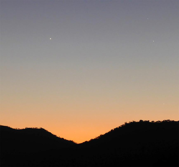 View larger. Evening dusk on August 4: Venus to the left. At right, Regulus is at top, Jupiter is below Regulus, and Mercury lies beneath the both of them, near the horizon.
