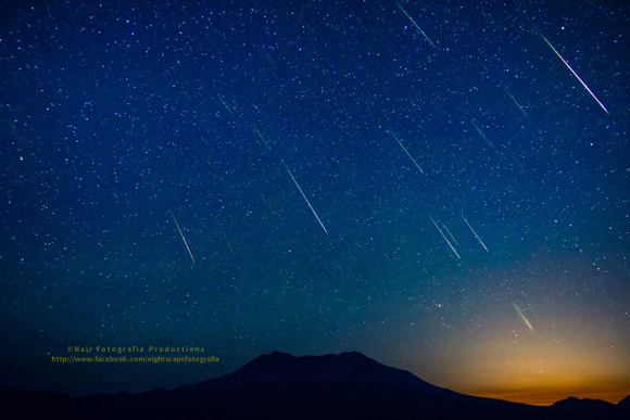 View larger. Nair Sankar reports that this is a blend of 15 exposures from Falling Rocks at the Caldera - Mt. St. Helens Monument and the Perseids, shot after 3 am in the morning. Thank you Nair!