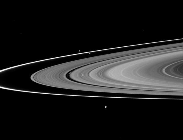 View larger. | The narrow F ring located just outside of the outer edge of the main rings. Two satellites sandwiching the F ring slightly above and to the left of the center of the image are the shepherd satellites Prometheus (inner orbit) and Pandora (outer orbit).