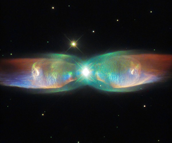 View larger. | The Twin Jet Nebula, aka PN M2-9, is what's called a planetary nebula, formed, in this case, when the central object is not a single star, but a binary system, Studies have shown that the nebula's size increases with time, and measurements of this rate of increase suggest that the stellar outburst that formed the lobes occurred just 1200 years ago.  Image via ESA/Hubble and NASA.