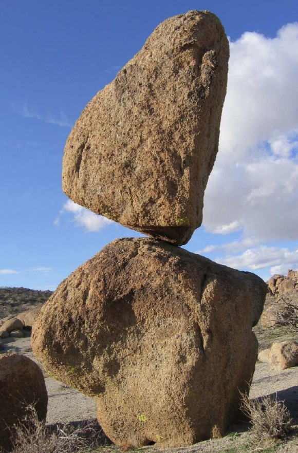 A precariously balanced rock near Searchlight, Nevada. Fragile features such as this are easily toppled by shaking from strong earthquakes. Similar formations near California's San Andreas Fault provide critical insights into the shaking and rupture patterns of past earthquakes. Photo credit: Nick Hinze / Nevada Bureau of Mines & Geology