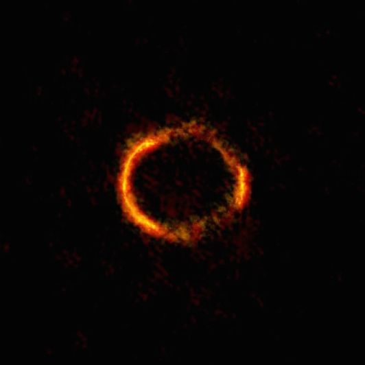 Highest-resolution observation ever of the gravitational lens system SDP.81, and its resulting Einstein ring. Image via ALMA (NRAO/ESO/NAOJ); B. Saxton NRAO/AUI/NSF