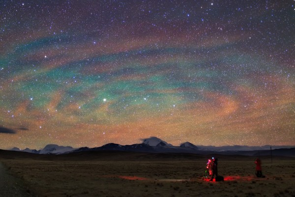The Image above shows an incredible display of airglow as oberseved at Tibet Plateau of China, 4450 meters above sea level. Airglow is the natural emission from the Earth upper atmosphere in green and red-yellow bands.