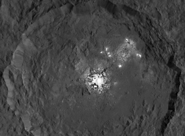 View larger. | Occator crater on Ceres, home to what's now seen as a collection of intriguing bright spots. Image via NASA/JPL-Caltech/UCLA/MPS/DLR/IDA