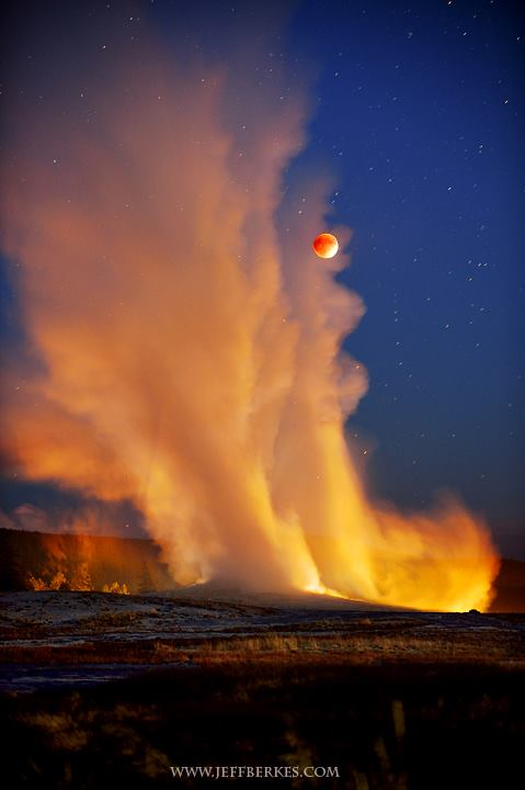 Old Faithful geyser at Yellowstone National Park erupts during Blood Moon maximum eclipse!