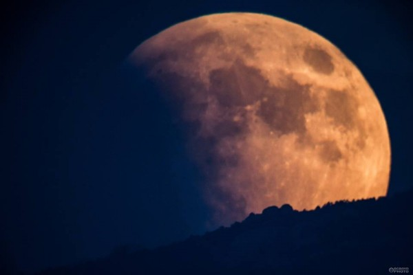 September 27-28, 2015 moon in partial eclipse, rising in Tucson, Arizona, as captured by BG Boyd Photo.