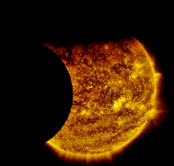 NASA's Solar Dynamics Observatory captured this image of Earth and the moon transiting the sun together on Sept. 13, 2015. The edge of Earth, visible near the top of the frame, appears fuzzy because Earth's atmosphere blocks different amounts of light at different altitudes. On the left, the moon's edge is perfectly crisp, because it has no atmosphere. This image was taken in extreme ultraviolet wavelengths of 171 angstroms. Though this light is invisible to our eyes, it is typically colorized in gold.  Image via NASA/SDO