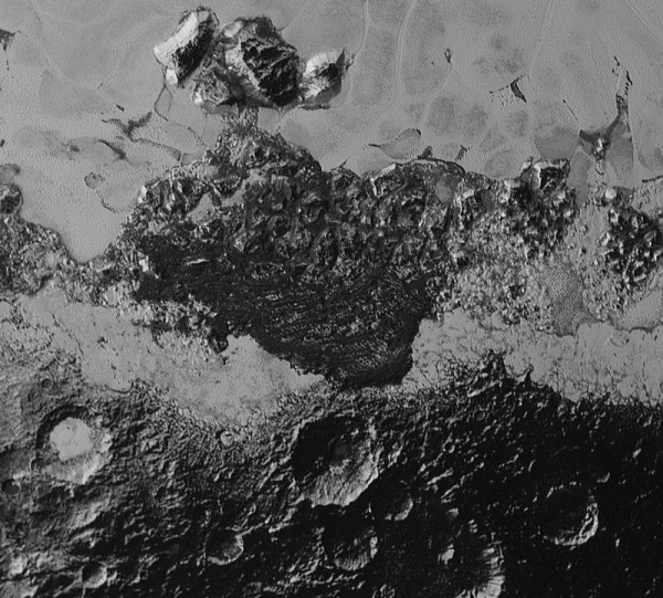 Some regions on Pluto are much darker than others.  Scientists aren't sure why.