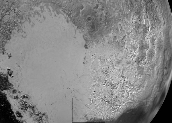 Pluto's 'Heart': Sputnik Planum is the informal name of the smooth, light-bulb shaped region on the left of this composite of several New Horizons images of Pluto. The brilliantly white upland region to the right may be coated by nitrogen ice that has been transported through the atmosphere from the surface of Sputnik Planum, and deposited on these uplands. The box shows the location of the glacier detail images below. Image credit: NASA/JHUAPL/SwR