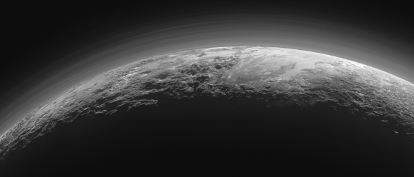 Pluto's Majestic Mountains, Frozen Plains and Foggy Hazes: Just 15 minutes after its closest approach to Pluto on July 14, 2015, NASA's New Horizons spacecraft looked back toward the sun and captured this near-sunset view of the rugged, icy mountains and flat ice plains extending to Pluto's horizon. The smooth expanse of the informally named icy plain Sputnik Planum (right) is flanked to the west (left) by rugged mountains up to 11,000 feet (3,500 meters) high, including the informally named Norgay Montes in the foreground and Hillary Montes on the skyline. To the right, east of Sputnik, rougher terrain is cut by apparent glaciers. The backlighting highlights over a dozen layers of haze in Pluto's tenuous but distended atmosphere. The image was taken from a distance of 11,000 miles (18,000 kilometers) to Pluto; the scene is 780 miles (1,250 kilometers) wide. View larger. | Image credit: NASA/JHUAPL/SwRI