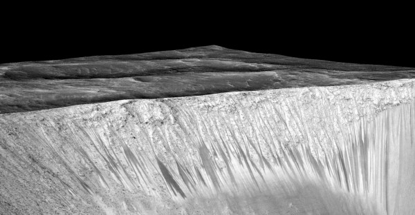 Dark narrow streaks called recurring slope lineae emanating out of the walls of Garni crater on Mars. The dark streaks here are up to few hundred meters in length. They are hypothesized to be formed by flow of briny liquid water on Mars. The image is produced by draping an orthorectified (RED) image (ESP_031059_1685) on a Digital Terrain Model (DTM) of the same site produced by High Resolution Imaging Science Experiment (University of Arizona). Vertical exaggeration is 1.5. Credits: NASA/JPL/University of Arizona