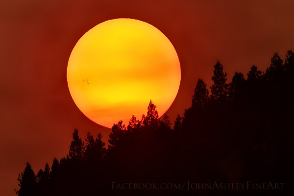 One of our favorite photographers, John Ashley, captured this image of AR2403 on August 20, as the spot had just appeared over the edge of the sun from his location at Rogers Lake, Montana.