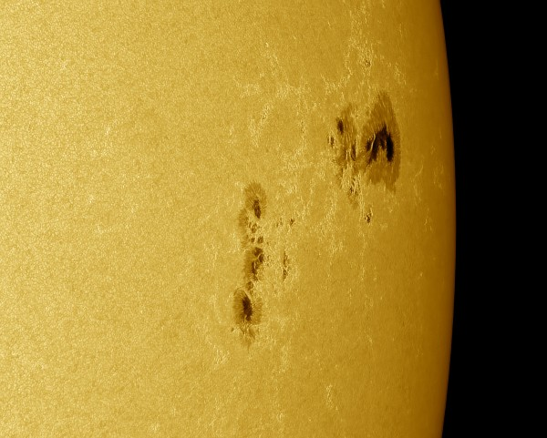 Giant sunspot group AR2403 as it was leaving the Earth-facing side of the sun.  Photo by Maximus Photography.  Read more about this image.