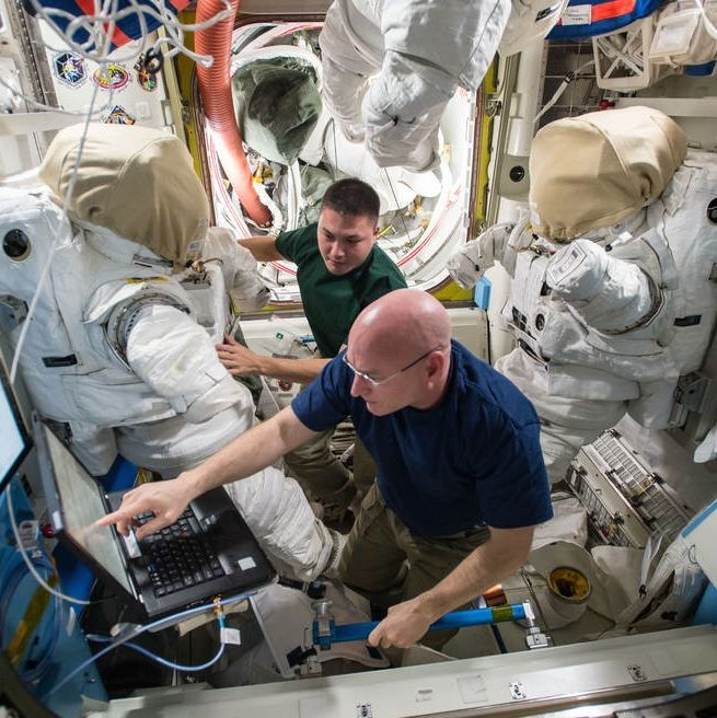 Expedition 45 commander Scott Kelly and flight engineer Kjell Lindgren prepare their extravehicular mobility unit spacesuits and tools in the Quest airlock. Kelly and Lindgren will use the spacesuits for two upcoming spacewalks outside the International Space Station on Oct. 28 and Nov. 6, 2015.