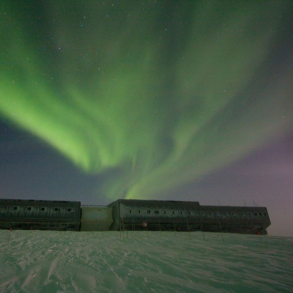 July 10, 2008 aurora at south pole.  Notice the greenish tint to the snow. Photo Credit: Dr. Keith Vanderlinde, NSF