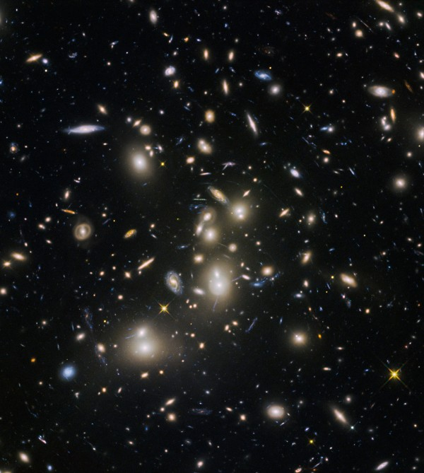 View larger. | Abell 2744, nicknamed Pandora's Cluster, was the first of six targets within the Frontier Fields programme, which together have produced the deepest images of gravitational lensing ever made. The cluster is thought to have a very violent history, having formed from a cosmic pile-up of multiple galaxy clusters. Image via NASA, ESA and the HST Frontier Fields team (STScI).