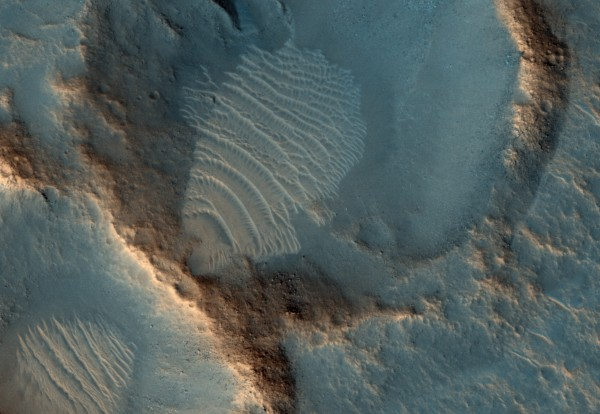 View larger. | Closeup of a crater in the Acidalia Planitia region on Mars. This image marks the exact coordinates on Mars of the fictional landing site of the Ares 3 mission, from the novel and movie The Martian. Notice the wind-blown dust! Image via the High Resolution Imaging Science Experiment (HiRISE) camera on NASA's Mars Reconnaissance Orbiter.  Read more about this image.