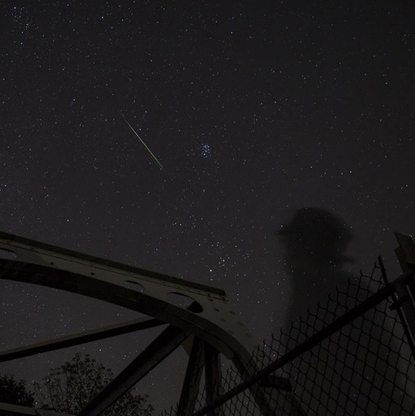 Meteor in front of constellation Taurus. Notice the dipper-shaped Pleiades and V-shaped Hyades below them. Cold Spring, New York - September, 2015 - 2 a.m.  Photo by Isaac Rodriguez.