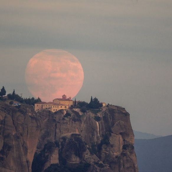 Moon rising behind the Metéora monastery in Greece. It's one of the largest and most important complexes of Greek Orthodox monasteries in Greece, second only to Mount Athos. Photo via Aimilianos Gkekas