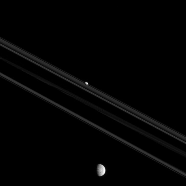 Saturn's rings, and two of its moons, Mimas and Pandora.  Image via Cassini spacecraft.