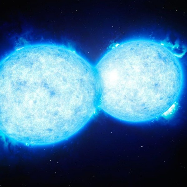 This artist's impression shows VFTS 352 — the hottest and most massive double star system to date where the two components are in contact and sharing material. The two stars in this extreme system lie about 160 000 light-years from Earth in the Large Magellanic Cloud. This intriguing system could be heading for a dramatic end, either with the formation of a single giant star or as a future binary black hole.  Image via ESO