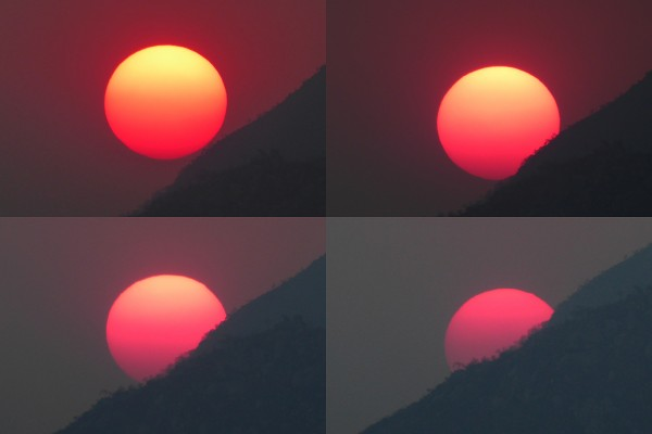View larger. | Sun changing color as it sets through smoke haze.  Captured October 10, 2015 in Mutare, Zimbabwe by Peter Lowenstein.