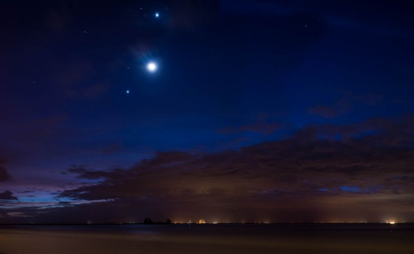 Moon and company on October 9.  Jupiter on the bottom, Mars above Jupiter, Venus above the moon and the star Regulus above and to the left of Venus. Photo by Ted Schultz in Florida.