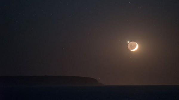 As seen from Australia on the morning of October 9, the moon passed in front of Venus.  Colin Legg caught this shot at Bremer Bay and wrote: