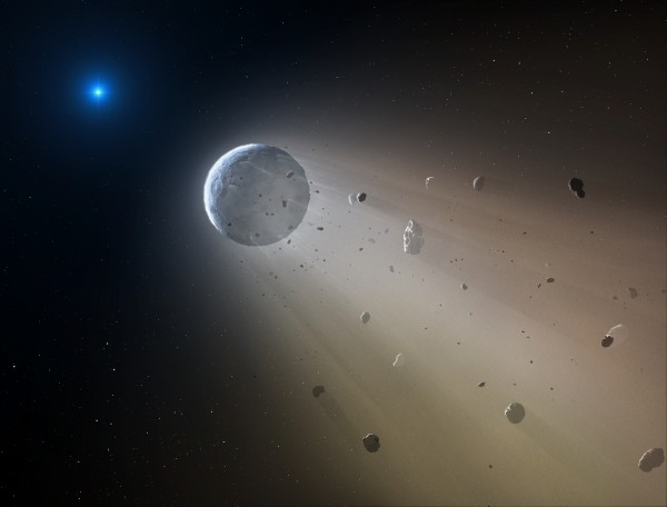 In this artist's conception, a tiny rocky object vaporizes as it orbits a white dwarf star. Astronomers have detected the first planetary object transiting a white dwarf using data from the K2 mission. Slowly the object will disintegrate, leaving a dusting of metals on the surface of the star.Image credit: CfA/Mark A. Garlick