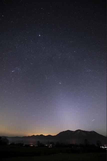 Zodiacal light photo by Noriaki Tanaka, taken on March 23, 2014. Look closely and you might see the constellation Orion to the left of center. The tip of the cone brushes against the Pleiades star cluster. The bright object to the upper left is the planet Jupiter, when it was in front of the constellation Gemini. In 2016, Jupiter shines in front of the constellation Leo.