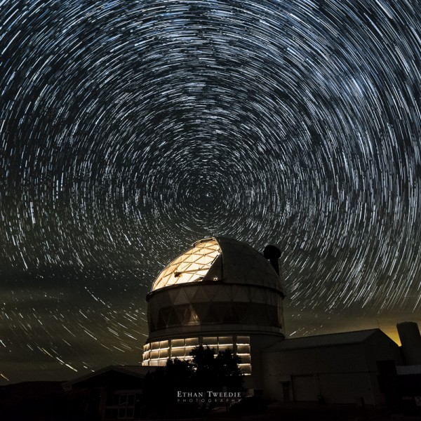 View larger. | Stars wheel around Polaris, above the Hobby-Eberly Telescope at McDonald Observatory in West Texas.  Image via Ethan Tweedle Photography.