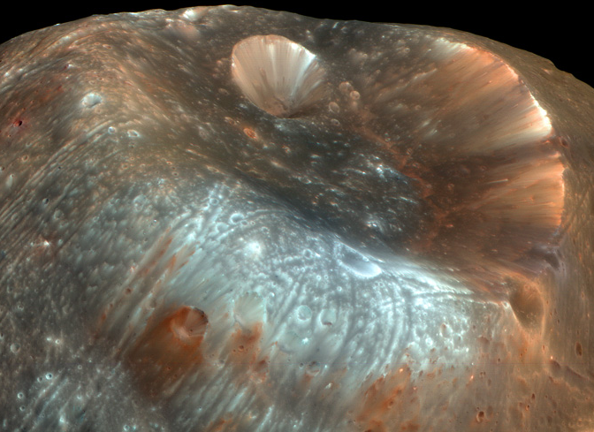 The Stickney crater at one end of Phobos was created by an impact that could have torn Phobos apart if the moon were less fractured and porous. Image from 2009.  Image credit: NASA