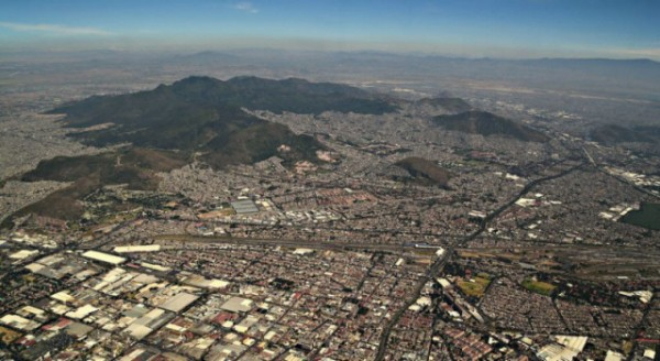 The extinct volcano Sierra de Guadalupe rises 750 metres above Mexico City, it's highest peak within 15 km of the centre of the city. In spite of conservation attempts, illegal buildings continue to sprout and at present the crater and debris avalanche have been completely covered by urban development.