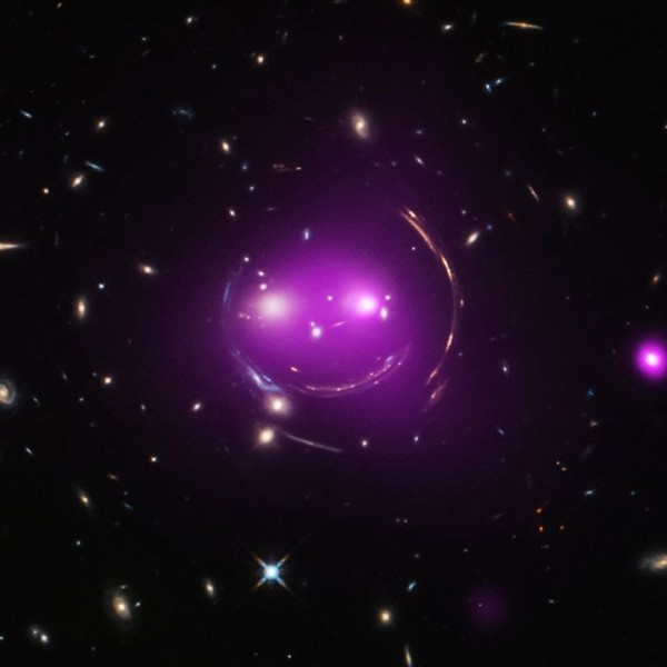 A composite image - combining x-ray and optical wavelengths - of the Cheshire Cat group of galaxies.  Image via Chandra X-Ray Observatory.