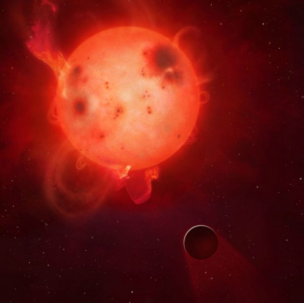 Kepler-438b: The planet Kepler-438b is shown here in front of its violent parent star. It is regularly irradiated by huge flares of radiation, which could render the planet uninhabitable. Here the planet's atmosphere is shown being stripped away. Superflares have energies roughly equal to or greater than 10^33 erg, about 10 times greater than the most powerful solar flare on record. They have been observed with energies up to around 10^36 erg - some 10,000 times the size of biggest solar flare.  Image credit: Mark A Garlick / University of Warwick