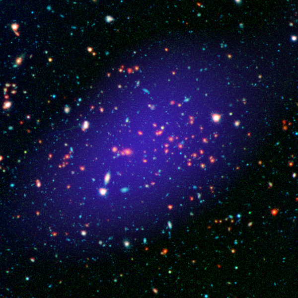The galaxy cluster called MOO J1142+1527 can be seen here as it existed when light left it 8.5 billion years ago. The red galaxies at the center of the image make up the heart of the galaxy cluster. Image credit: NASA/JPL